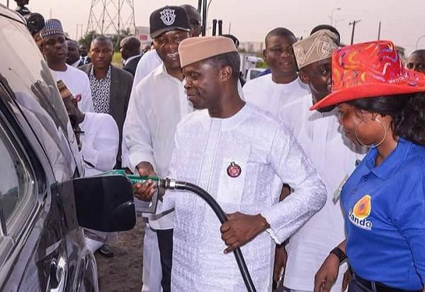 VP OSINBAJO DISPENSES FUEL IN THE NIGHT AT OANDO FILLING STATION, LAGOS