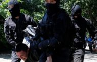 KAZAKHSTAN SLAMS FINES, SUSPENSION ON JEHOVAH'S WITNESSES AFTER RAID BY 40 ARMED MASKED MEN